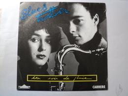 45 TOURS BLUES TROTTOIR. 1987. UN SOIR DE PLUIE / LE JOUR SUIVANT. CARRERE 14 298 ARTISTES CREDITES CLEMENCE LHOMME / J - Vinyles