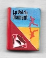 Féve  Livre  Le  Vol  Du  DIAMANT  Recto  Verso - Fèves