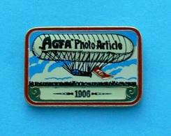 1 PIN'S //  ** AGFA / PHOTO / ARTICLE / DIRIGEABLE 1906 ** . (L'Épinglerie Québec) - Fotografie