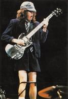 AC/DC - Angus YOUNG - Guitariste - Chanteurs & Musiciens
