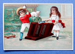 CHROMO.CHOCOLAT SUCHARD..... S 10.... +- 1900....ENFANTS QUI CASSENT UNE TABLETTE DE CHOCOLAT....PETIT CHAT - Suchard