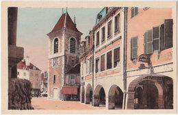 39. LONS-LE-SAUNIER. Rue Du Commerce Et Tour De L'Horloge - Lons Le Saunier