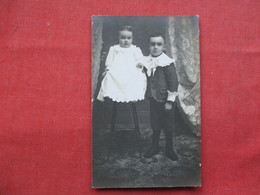 RPPC  Young Boy With Child On Chair Ref 3250 - Postcards