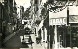 Photo Cpsm 75 PARIS XVIII. Tabac Rue Des Abbesses Et Moulin De La Galette Rue Tholozé Voiture Traction-avant - Arrondissement: 18