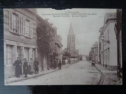SAINT GATIEN DES BOIS : RUE DE TROUVILLE, AU LOIN L'EGLISE - France