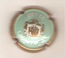 CAPSULE MUSELET CHAMPAGNE  DEUTZ AY FRANCE N025 (turquoise Or Et Blanc) - Deutz