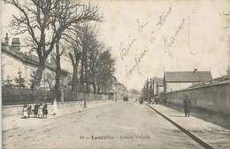 CPA LUNEVILLE Meurthe-et-Moselle. AVENUE VOLTAIRE. ENFANTS. Vue Inhabituelle. Carte écrite - Luneville