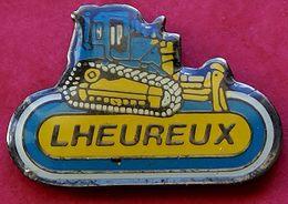 JJ...406..ENGINS DE CHANTIER/TRAVAUX PUBLIC/ELEVATEURS/TRACTEURS....... LHEUREUX - Pin's