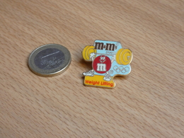 JEUX OLYMPIQUE ATLANTA 1996. USA. M&M's.  EGF. HALTEROPHILIE WEIGHT LIFTING. - Jeux Olympiques