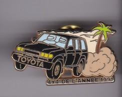 Pin's TOYOTA 4X4 DE L'ANNE 91 SIGNE ARTHUS BERTRAND - Toyota