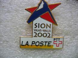 Pin's Des Jeux Olympiques De SION Dans Le Valais Suisse En 2002 Avec Le Partenariat De La Poste, PTT - Jeux Olympiques