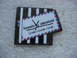 Pin's Ammesty International, Ecrire Contre L'oubli - Associations