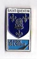 Pin's LA VOIX DE L'AISNE - SAINT QUENTIN - BLASON - Médias