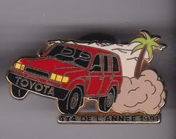 Pin's  TOYOTA 4X4 DE L'ANNEE 1991 SIGNE ARTHUS BERTRAND - Toyota