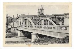 NOMENY   (cpa 54)   Le Pont Et La Rue Clémenceau   -  L 1 - Nomeny