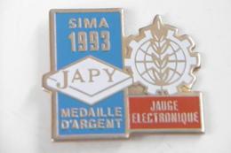"""Pin's - SIMA 1993 """"JAPY"""" Médaille D'argent JAUGE ELECTRONIQUE - Marques"""