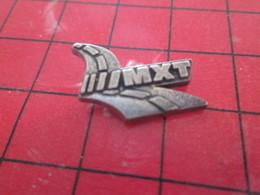 413E  Pins Pin's  / Rare & Belle Qualité / THEME AUTOMOBILE : PNEUS MICHELIN MXT Par PICHARD SAUMUR - Pin's