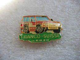 Pin's Dd'un 4x4 Patrol Du Constructeur NISSAIN Appartenant Aux Ets Franco-Suisse - Pin's