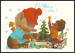USSR, 1986. HAPPY NEW YEAR! BABY ELEPHANT, TEDDY BEAR AND BUNNY. Artist V. ZARUBIN. Unused Postal Stationery Card - Elefanten