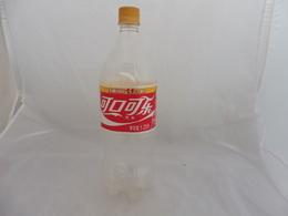 COCA COLA® BOUTEILLE PLASTIQUE VIDE CHINE 2007 1.25L - Flessen