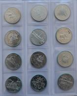 Kanada: Ein Album Mit 45 Silbermünzen Aus Kanada. Dabei 28 Gedenkdollar 1980-2007 Sowie 17 X 1 OZ Ma - Canada