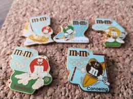 5  Pins Sur Les Chocolats Friandise M Et Ms Jeux Olympique Canoe Base Ball Tir A Larc Voile Et Ski - Lebensmittel