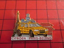 412a Pin's Pins / Beau Et Rare / THEME : AUTOMOBILES / RALLYE PARIS PEKIN TOUR EIFFEL KREMLIN CITROEN - Rallye