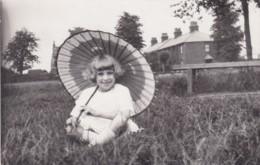 GIRL SAT IN FIELD WITH PARASOL - Children