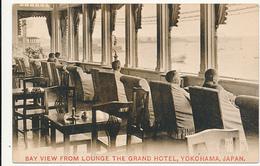 BAY VIEW FROM LOUNGE THE GRAND HOTEL, YOKOHAMA, JAPAN. PEOPLE LOOKING AT HARBOR - Yokohama