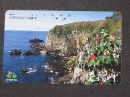 JAPAN PHONECARD NTT 370-097 CLIFF LIGHTHOUSE FLOWERS - Japan