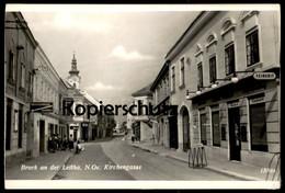 ALTE POSTKARTE BRUCK A.D. LEITHA N.O. KIRCHENGASSE FEINKOST JOHANN WINKLER VERSICHERUNGEN REISEBÜRO Cpa AK Postcard - Bruck An Der Leitha