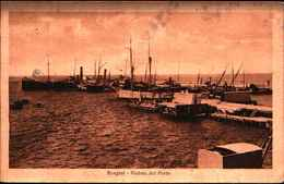"""3702) Cartolina Di Bengasi - Veduta Del Porto - Con Bollo Blu -R. Cannoniera """"Augusta""""- Viaggiata Il 14/07/1928 - Libia"""