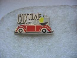 Pin's COXtime. Coccinelle De Chez Wolkswagen Décapotée. Océan VW Club - Volkswagen