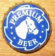 N°555 CAPSULE DE BIERE ET AUTRE - Bière