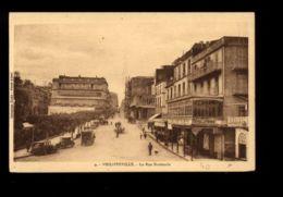 C1310 ALGERIE - SKIKDA FORT DE FRANCE PHILIPPEVILLE - LA RUE NATIONALE AVEC VOITURES HOTEL DE FRANCE ANIMATION - Skikda (Philippeville)
