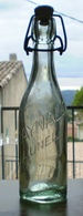 """RAYNAUD Lunel, Bouteille Bouchon Porcelaine; """"Bouteille à Rendre"""" Verre à Bulles. Hauteur 24 Cms - Otras Botellas"""