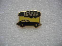 Pin's AD Carrosserie Sports 2000 à Savigny Sur Orge (Dépt 91) - Badges