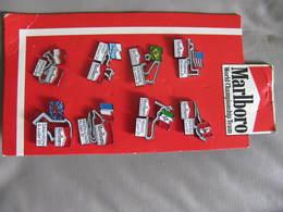 8 PIN'S MARLBORO WORLD CHAMPIONSHIP TEAM 1991 - CIRCUITS AUTOMOBILE FORMULE 1 - Sur Carton. - Pin's