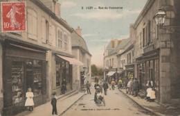 W20- 58) LUZY (NIEVRE)  RUE DU COMMERCE - (TRES ANIMEE - COULEURS) - Other Municipalities