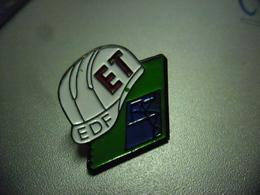 Pin's EDF GDF Casque ET @ 21 Mm X 21 Mm - EDF GDF