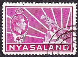 NYASALAND 1938 KGVI 4d Bright Magenta SG135 FU - Nyasaland (1907-1953)