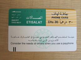 UAE #20 Tamura Phonecard,slogan,used With Tiny Scratch - United Arab Emirates
