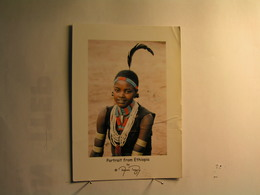 Girl With Feather In DDimeka - Ethiopia