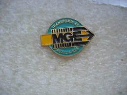 Pin's Des Transports MGE (Magasins Généraux D'Epinal): Transports Et Auxiliaires - Transportation