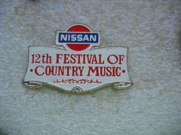 Pin's Du 12th Festival Of COUNTRY MUSIC, Sponsorisé Par Les Automobiles NISSAN - Música