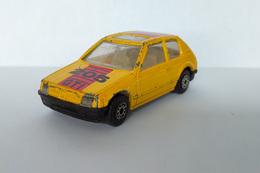 "Miniature ""3 Inches"" 1/64 MC Toy - Peugeot 205 GTi Jaune - HotWheels"