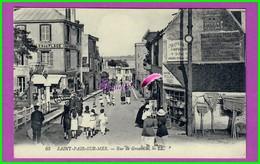 CPA  (50 Manche) SAINT ST PAIR SUR MER - 63. Rue De Granville - Très Animé Vue Sur Les Commerce - écrite Au Dos - Saint Pair Sur Mer
