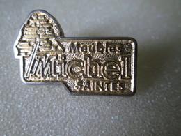 PIN'S  MEUBLES MICHEL  SAINTES - Marcas Registradas
