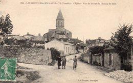 Moutiers Les Mauxfaits : L'église, Vue De La Rue Du Champ De Foir - Moutiers Les Mauxfaits