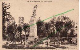 LINGREVILLE  MONUMENT AUX MORT A DROITE EGLISE DE TOURNEVILLE - France